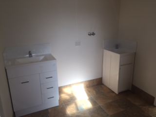 laundry connections and space for washing machine in bathroom